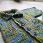 Cum sa tricotam in relief o vesta si un pantalon scurt pentru copilul nostru